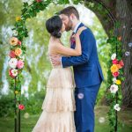 THE BROCKHOUSE VANCOUVER WEDDING FLORAL ARCH BHLDN ROSECLIFF GOWN SIMONS BLUE SUIT BUBBLES