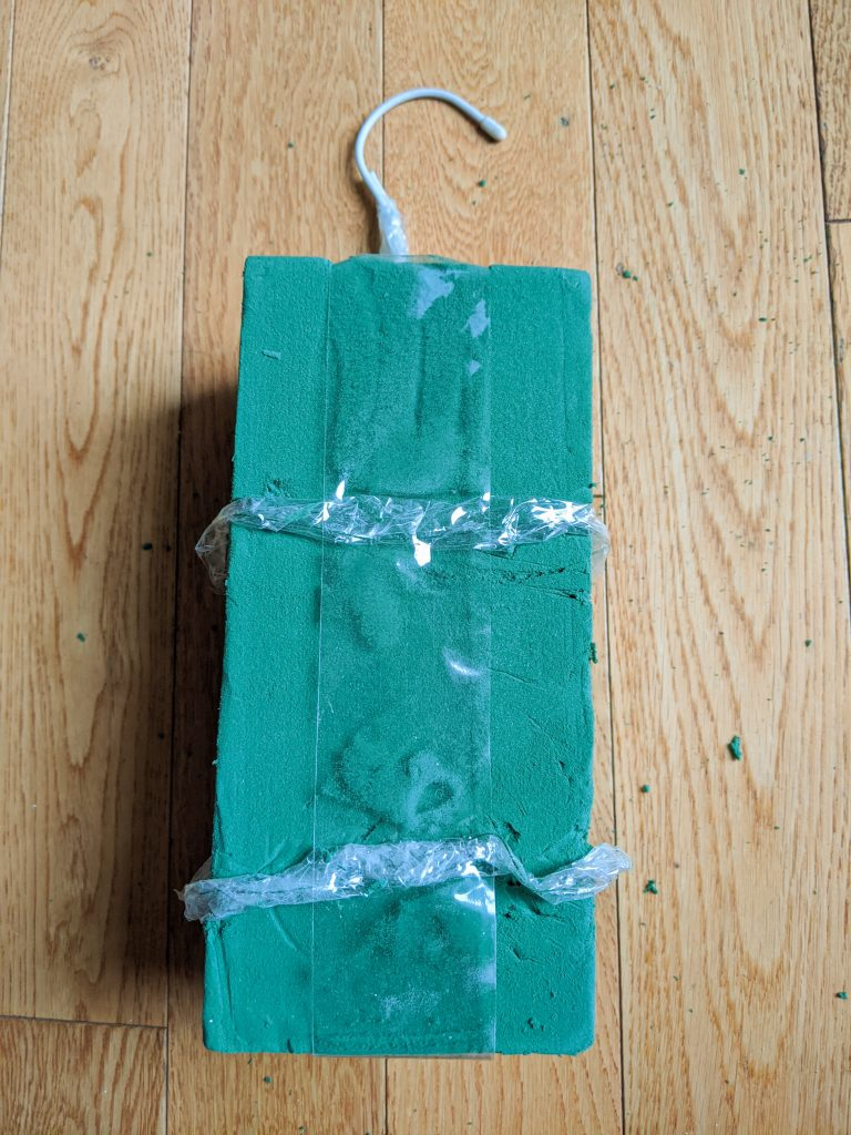 add tape to floral foam DIY holiday Christmas porch light decor Montreal lifestyle beauty fashion blog