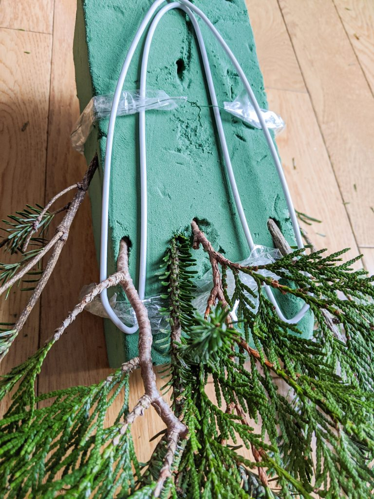 stick greenery in floral foam DIY holiday Christmas porch light decor Montreal lifestyle beauty fashion blog