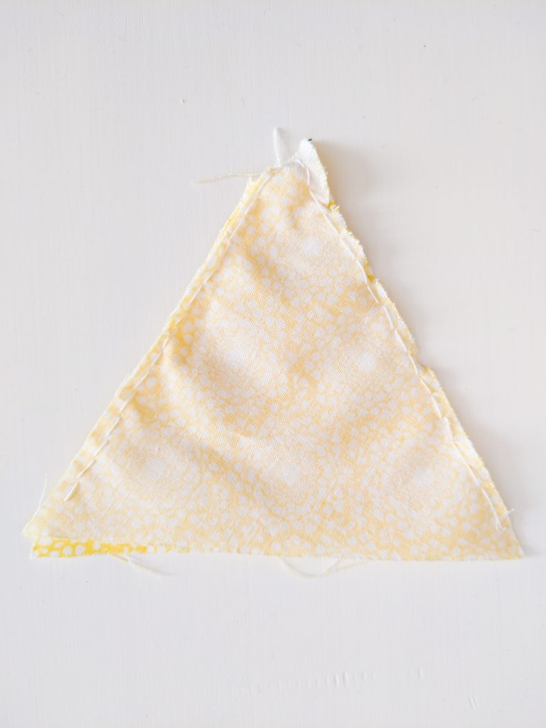 sew triangles together DIY birthday party bunting banner Montreal lifestyle fashion beauty blog