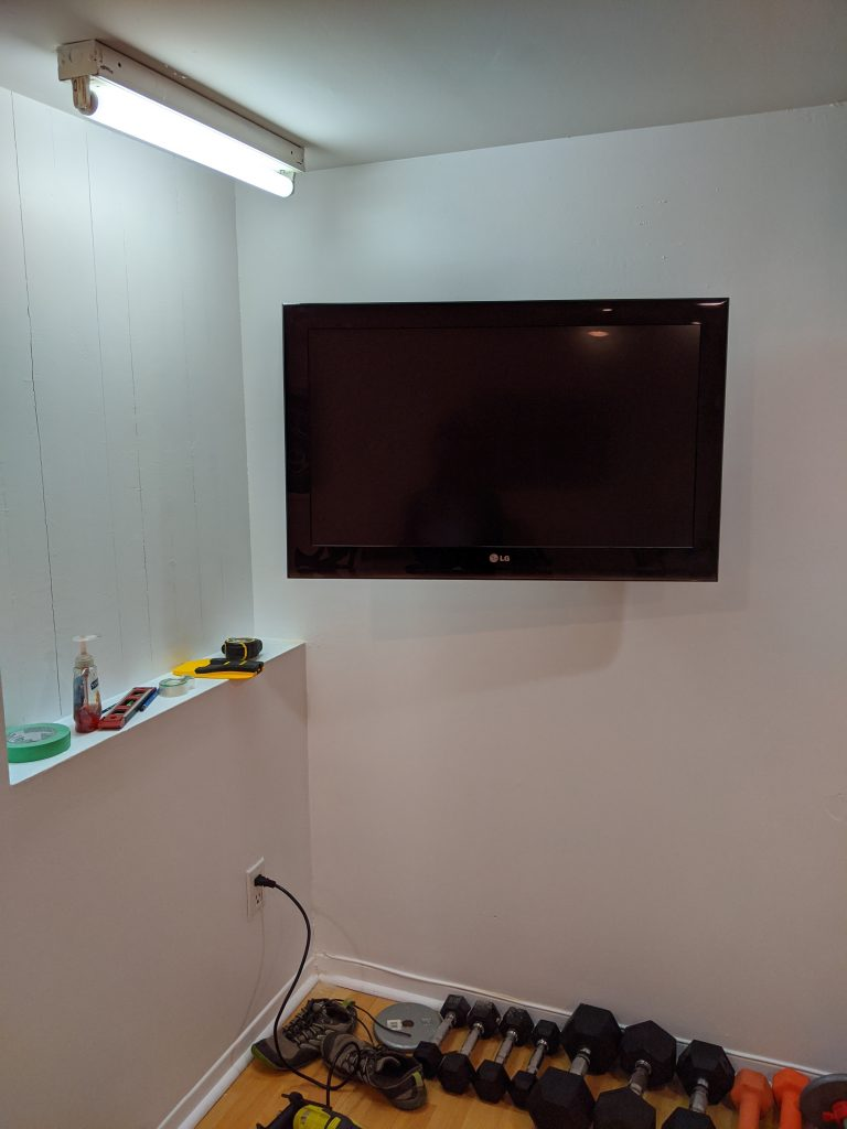 mount TV to wall DIY multi-purpose basement gym remodel Montreal lifestyle fashion beauty blog 2