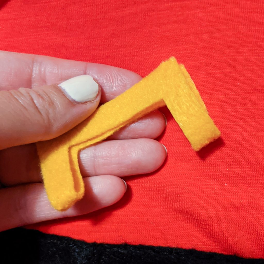 sew buckle onto belt DIY toddler Gaston Halloween costume Montreal lifestyle fashion beauty blog