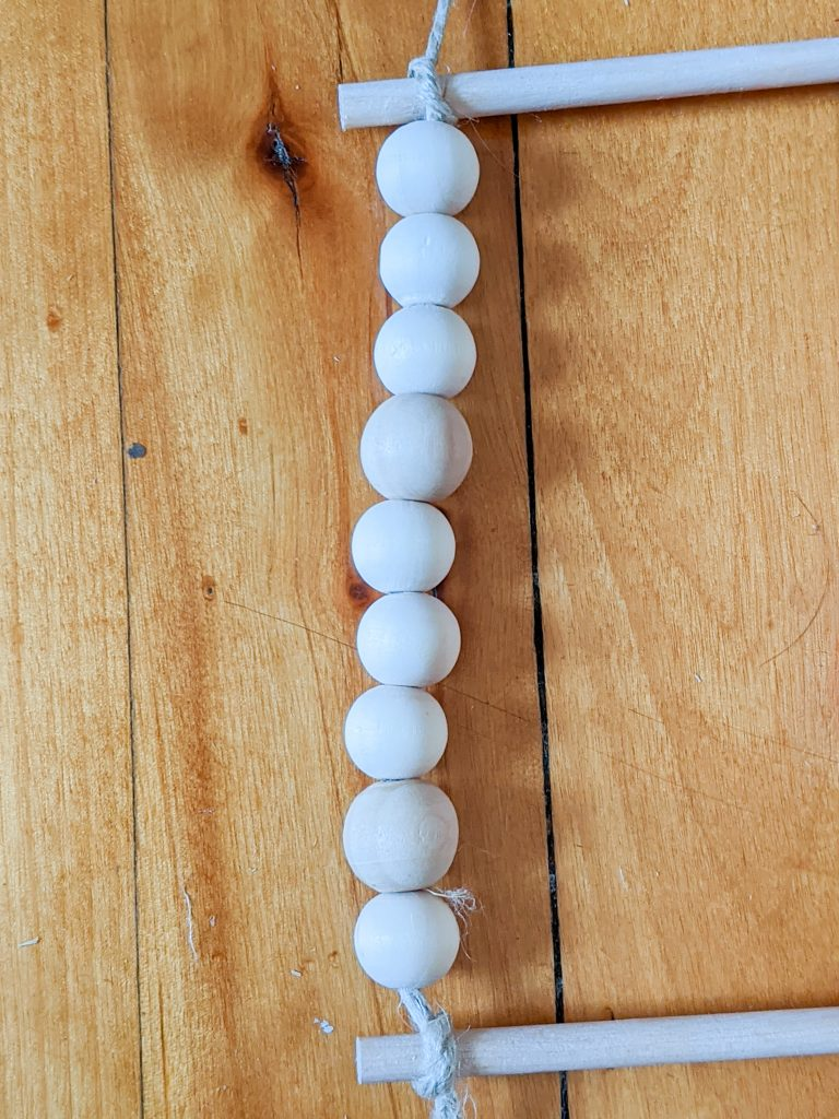 add wooden beads to string DIY advent calendar Montreal lifestyle fashion beauty blog