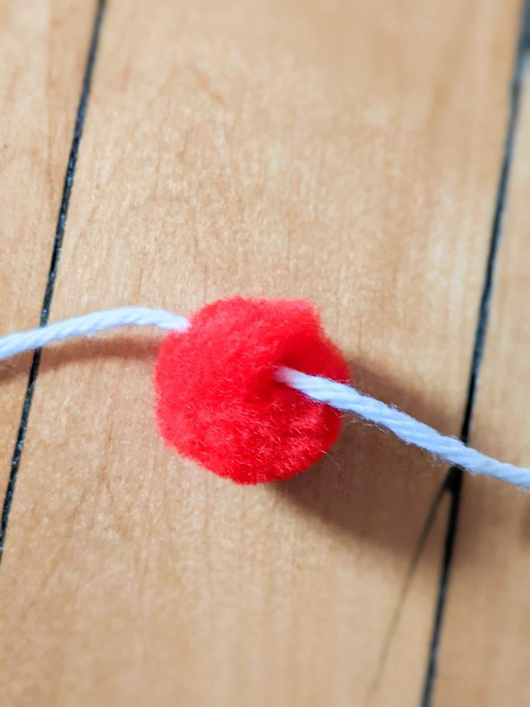 pull thread through DIY pompom garland Montreal lifestyle fashion beauty blog