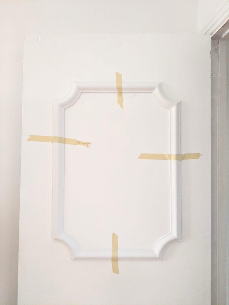 decide panel placement DIY door makeover installing decorative trim moulding Montreal lifestyle fashion beauty blog
