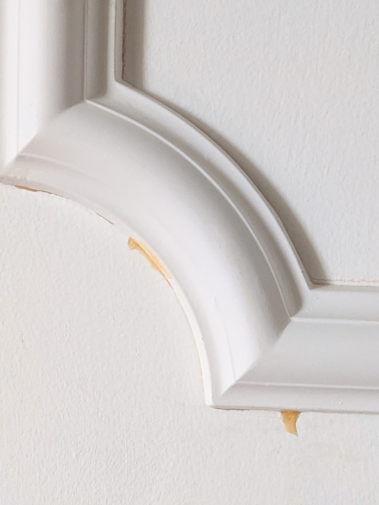 wood glue drops DIY door makeover installing decorative trim moulding Montreal lifestyle fashion beauty blog